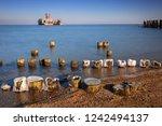 frozen wooden breakwaters line... | Shutterstock . vector #1242494137