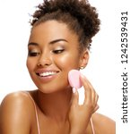 young girl applying foundation...   Shutterstock . vector #1242539431
