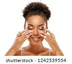 beautiful woman doing facial... | Shutterstock . vector #1242539554