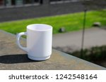 white mug against defocused... | Shutterstock . vector #1242548164