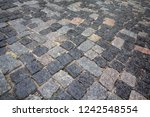 wet stone pavement in... | Shutterstock . vector #1242548554