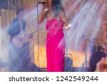 singer with a microphone... | Shutterstock . vector #1242549244