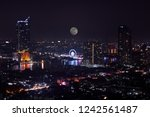 scenic of night cityscape with... | Shutterstock . vector #1242561487