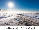 winter landscape at fog  with road near farm - stock photo