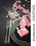Restaurant series. Valentines day dinner with table setting in pink and gray and holiday elegant heart ornaments - stock photo