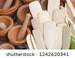 wooden paddles and mortars with ... | Shutterstock . vector #1242620341
