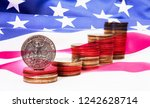 stack of dollar coins with... | Shutterstock . vector #1242628714