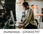 art director checking the... | Shutterstock . vector #1242631747