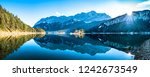 famous eibsee lake in front of zugspitze mountain in germany - stock photo