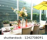 dinner table setting decorated... | Shutterstock . vector #1242708091