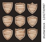 vector wood shield realistic... | Shutterstock .eps vector #1242733987