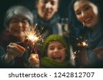 merry christmas and happy... | Shutterstock . vector #1242812707