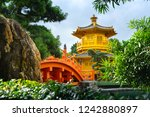 the golden pavilion temple at... | Shutterstock . vector #1242880897
