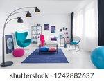 table on blue carpet in white... | Shutterstock . vector #1242882637