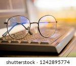 selective focus eyes glasses on ... | Shutterstock . vector #1242895774