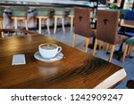coffee cup on the wooden table. ...   Shutterstock . vector #1242909247