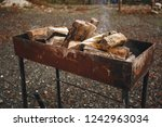 bonfire in the grill. punctured ... | Shutterstock . vector #1242963034