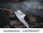 bonfire in the grill. punctured ... | Shutterstock . vector #1242963037
