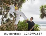 happy young couple on a... | Shutterstock . vector #1242991657