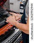 cropped shot of repairman... | Shutterstock . vector #1242992944