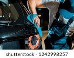 partial view of auto mechanic... | Shutterstock . vector #1242998257
