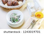 salad with champignons and... | Shutterstock . vector #1243019701