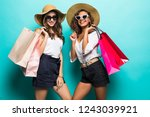 two happy girl friends with... | Shutterstock . vector #1243039921