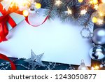 christmas gift boxes with red... | Shutterstock . vector #1243050877