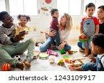 diverse children enjoying... | Shutterstock . vector #1243109917