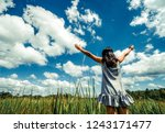 young beautiful woman on green... | Shutterstock . vector #1243171477