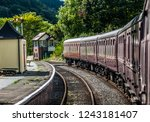 old train carriages at a... | Shutterstock . vector #1243181407