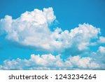 white fluffy cloud on blue sky. ... | Shutterstock . vector #1243234264