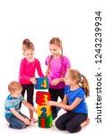 happy kids holding blocks with... | Shutterstock . vector #1243239934