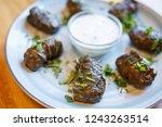 dolma   stuffed grape leaves... | Shutterstock . vector #1243263514