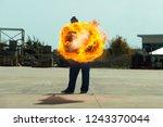 flamethrower in action.... | Shutterstock . vector #1243370044