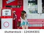 cute thai girl is waiting on... | Shutterstock . vector #124344301