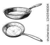 two skillets isolated on white... | Shutterstock .eps vector #1243548304