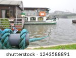 close up of a blue mooring rope ... | Shutterstock . vector #1243588891