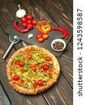 pizza on wood table with... | Shutterstock . vector #1243598587