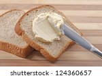 a knife spreading butter on... | Shutterstock . vector #124360657