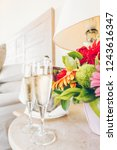two glasses of champagne in the ... | Shutterstock . vector #1243616347