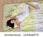 Sleeping young woman, view from above - stock photo