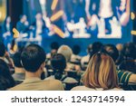 rear view of audience listening ... | Shutterstock . vector #1243714594