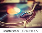 needle on the turntable record. ... | Shutterstock . vector #1243741477