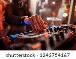 dj mixes the track in the... | Shutterstock . vector #1243754167