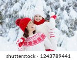 mother and child in knitted... | Shutterstock . vector #1243789441