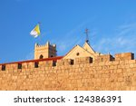 Flag of the Vatican on a tower of Latin residence in the Old City of Jerusalem (Israel) - stock photo