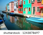 colorful houses on the island... | Shutterstock . vector #1243878697