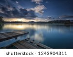 calm view of old jetty on... | Shutterstock . vector #1243904311