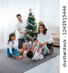 happy asian family decorate... | Shutterstock . vector #1243915444